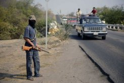 In tense Mexico state, vigilantes refuse to drop guns