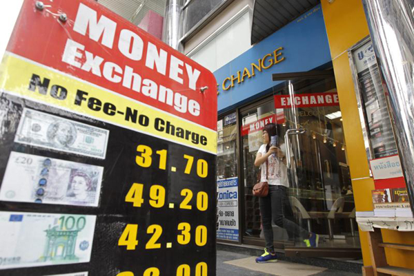 A Tourists Leaves Money Exchange In Bangkok The Thai Currency Drops Almost Three Month Low On Monday Morning Epa File Photo