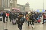 Millions in China travel home for holidays