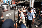 Police move to retake protest sites