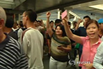 Forces descend on central Bangkok to stifle protests