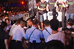 Police remove protester at democracy rally in Hong Kong