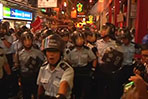 Protesters clash with riot police in Hong Kong