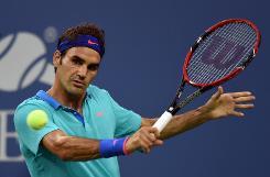 Wozniacki sends Sharapova out of US Open, Federer battles through