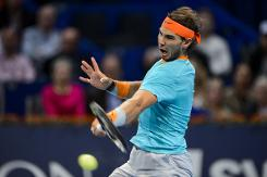 Federer, Nadal race through in Basel