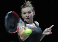 Halep seals semis spot without hitting a ball