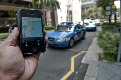 Singapore moves to regulate taxi booking apps