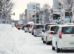 Up to 11 dead in Japan snow storms
