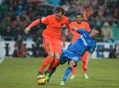 Barca hope to end year on Madrid's coattails
