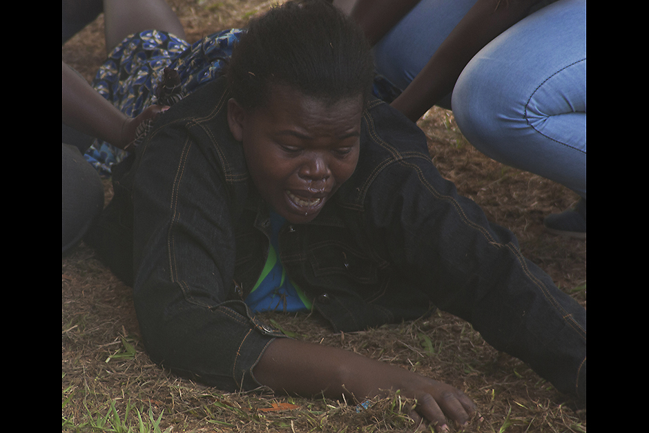 A woman falls to the ground after being overcome with grief after viewing the body of a relative killed in last Thursday's attack on Garissa University College in northeastern Kenya, at Chiromo funeral home, Nairobi, Kenya. Al-Shabab gunmen rampaged through the university at dawn Thursday, killing over 140 people in the group's deadliest attack in the East African country. Four militants were slain by security forces to end the siege just after dusk.