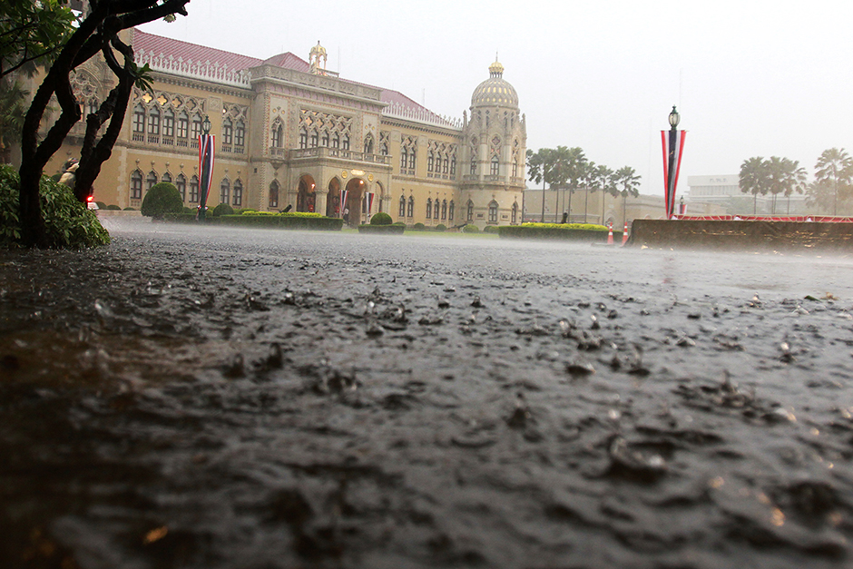 Government House is flooded after a downpour in Bangkok. Seasonal storms have caused heavy damage in eight provinces. Thanarak Khunton