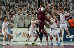 Hosts Qatar into world quarter-finals