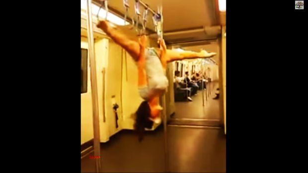Pole dancing on Bangkok subway: Don't try it