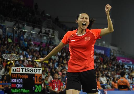 Wang Yihan fights back to reach All-England quarters