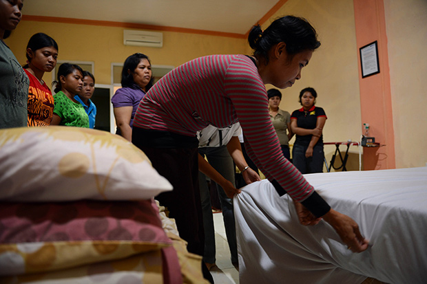 Indonesia bans maids from working in Mideast