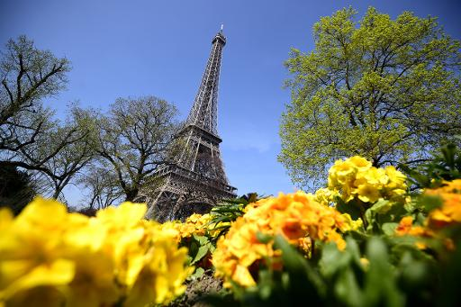 Eiffel Tower reopens after staff walk out