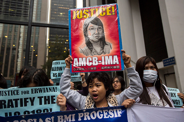Asia's migrant domestic workers rally to fight low pay, abuse