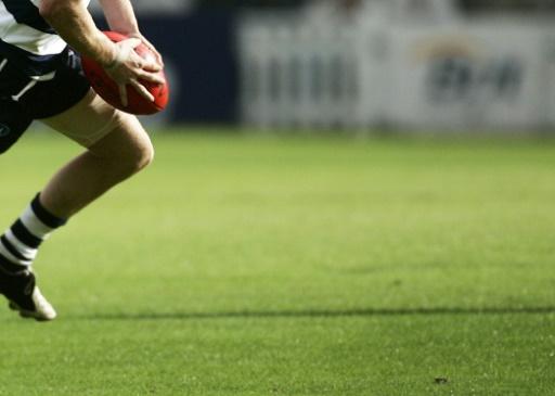 Adelaide Crows coach slain, son arrested
