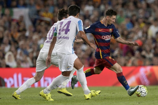Vermaelen helps Barca overcome stubborn Malaga