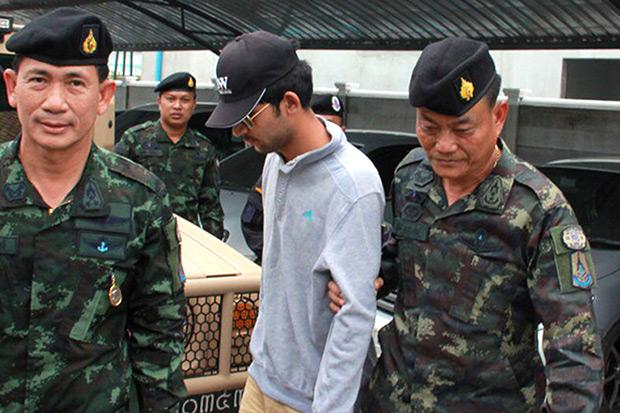 Authorities escort a prime suspect in the Aug 17 Erawan bombing after his arrest in Sa Kaeo province Tuesday. (NCPO handout photo)