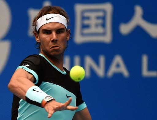 Nadal struggles past former ball boy at China Open