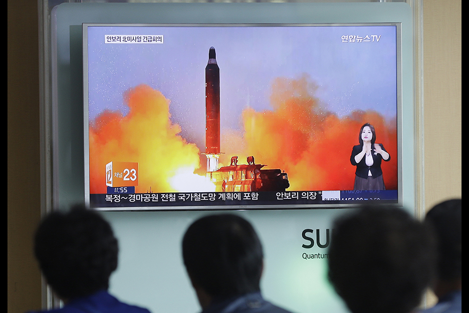 People watch a television news channel airing an image of North Korea's ballistic missile launch in North Korea's Rodong Sinmun newspaper at the Seoul Railway Station in Seoul, South Korea. North Korean leader Kim Jong Un trumpeted the success of a powerful new midrange ballistic missile test that state media says propelled one of the weapons more than 1,400 kilometres (870 miles), saying it would allow strikes on United States forces throughout the region.