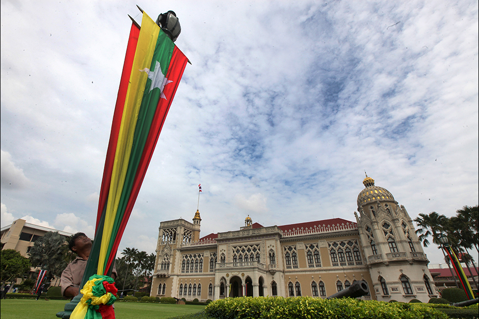 The national flag of Myanmar is raised at Government House grounds to welcome State Counsellor Aung San Suu Kyi, who is on a three-day visit to Thailand.