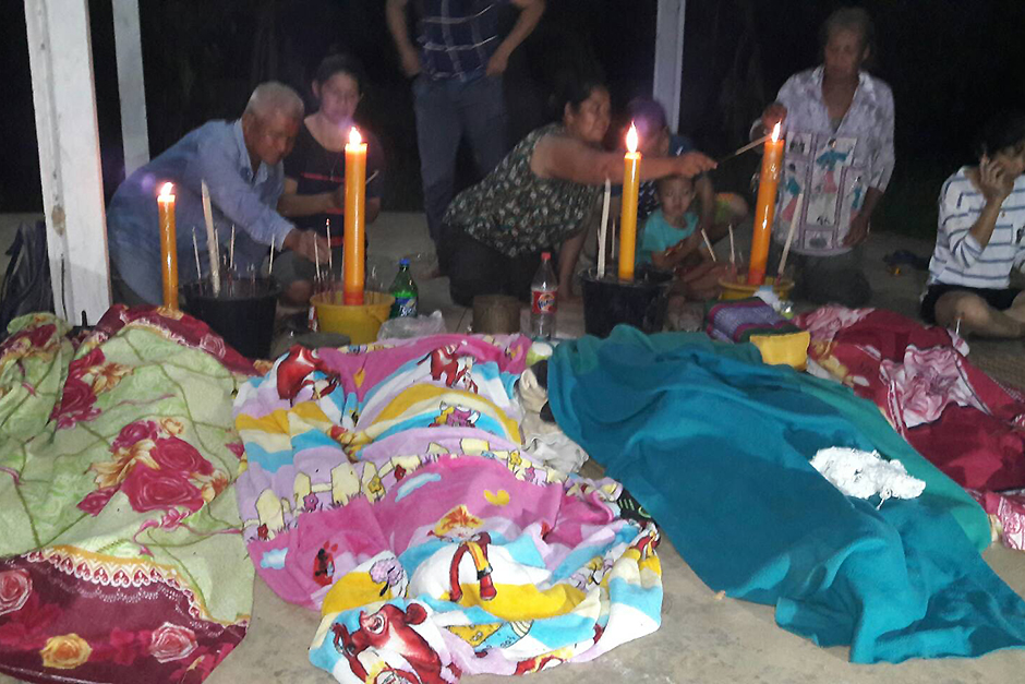 Grieving families of four young boys who drowned in a community creek in Ubon Ratchathani perform a religious ceremony for their 3-4 year-old sons at a local temple in Khuang Nai district