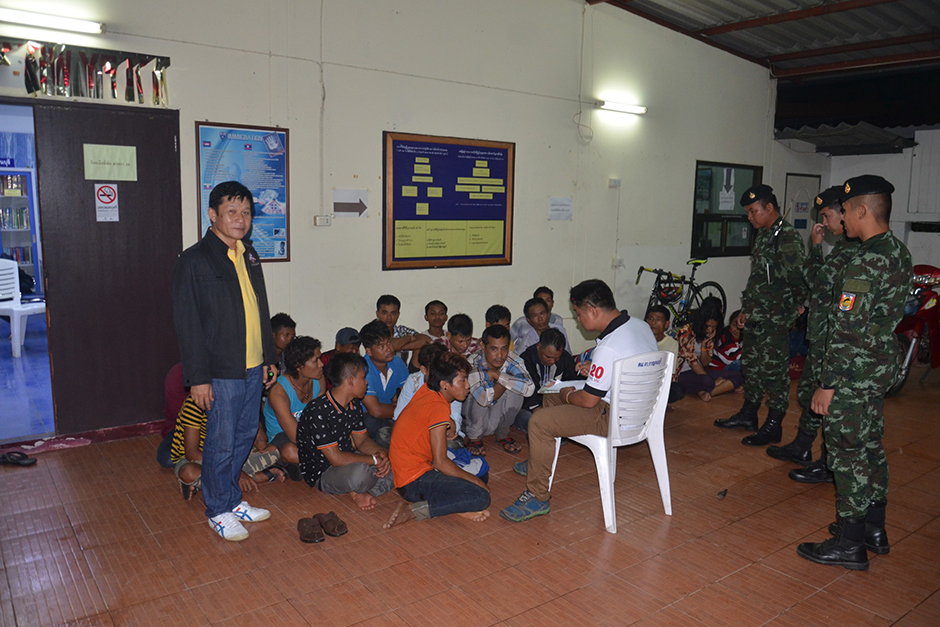 Twenty-five illegal Myanmar migrant workers caught in a smuggler's pickup truck in Kanchanaburi's Muang district are questioned at the Kanchanaburi immigration centre. The Thai driver, who was arrested, confessed he had done it at least 10 times before.