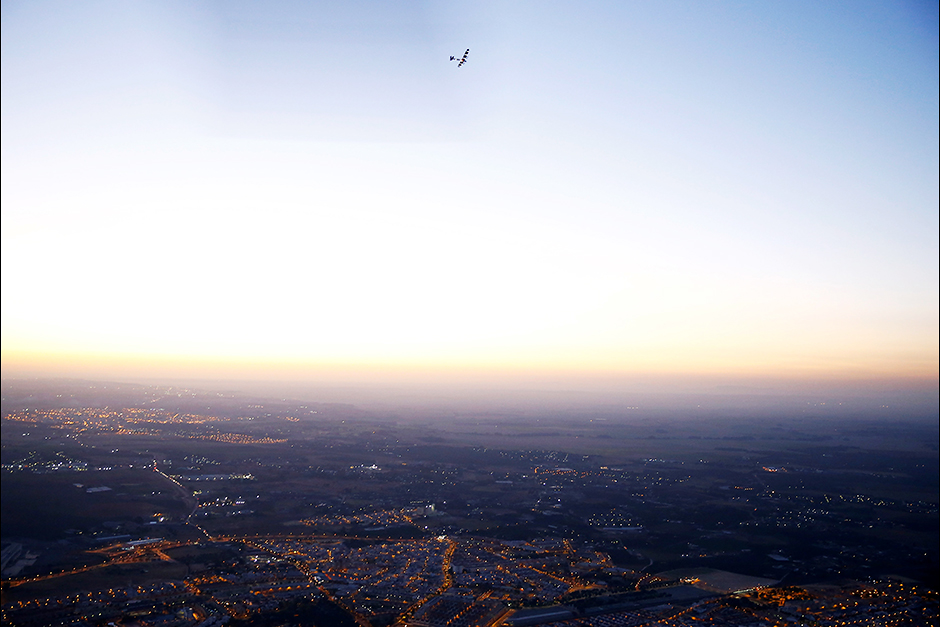 The solar-powered plane Solar Impulse 2, piloted by Swiss aviator Bertrand Piccard, is pictured before landing at San Pablo airport in Seville, southern Spain.