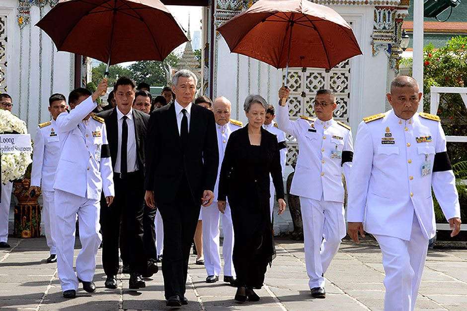Singapore Prime Minister Lee Hsien Loong and his wife Ho Ching arrive to pay respects to King Bhumibol at the Dusit Maha Prasat Throne hall inside the Grand Palace.