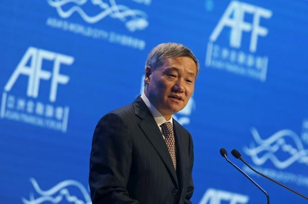 China's top securities regulator steps down