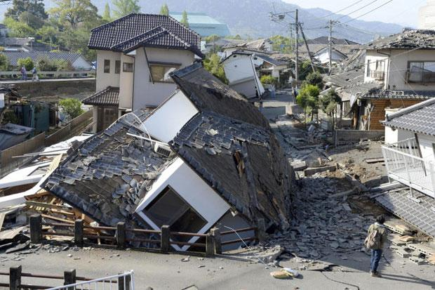 Houses are seen destroyed after an earthquake in Mashiki in Kumamoto prefecture in southern Japan on Saturday (Kyodo News via AP photo)