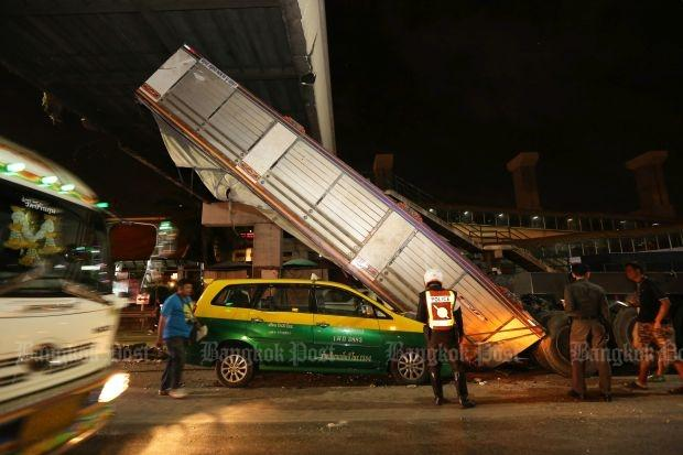 Police inspect accident scene after 22-wheel truck rips into airport ...