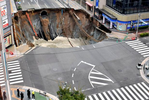 Japan: Sinkhole swallows parts of street, cutting off power, water, gas supplies