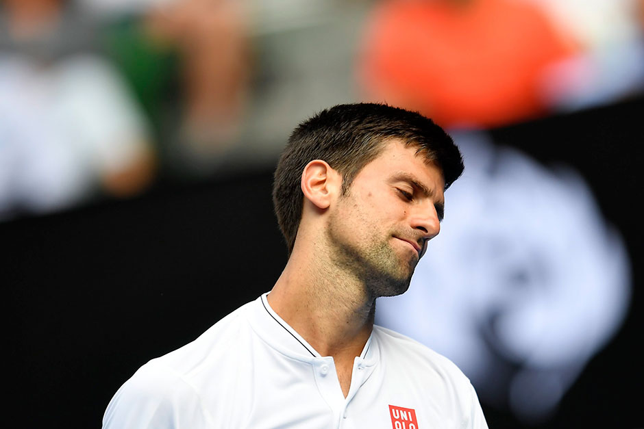 Djokovic out in upset loss to Istomin at Australia Open