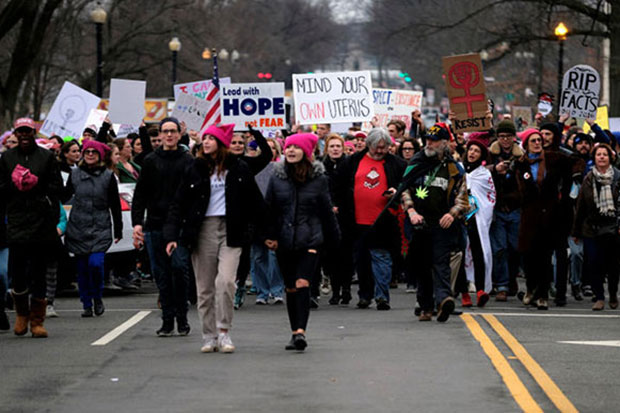 Women protesters swarm streets across US in challenge to Trump
