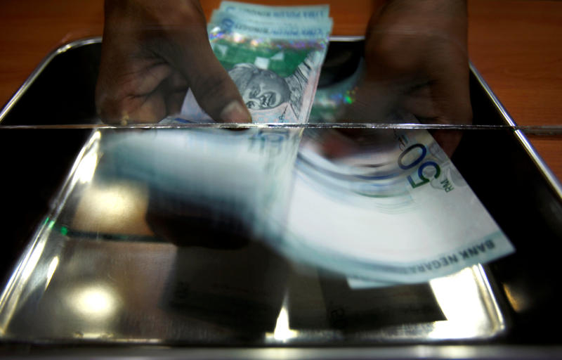 Ringgit trading slumps 70% offshore after central bank curbs