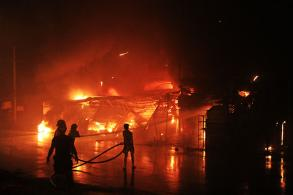 Couple jump to safety as fire guts auto parts shops
