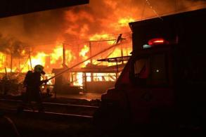 Woman dies in railway community fire