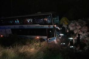 One killed, 6 hurt in bus-truck crash