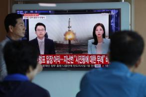 N.Korea says new missile can carry heavy nuke