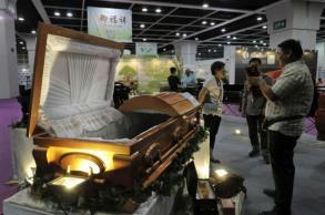 Asian funerals go green, high-tech at HK trade fair