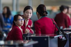 Cathay Pacific lays off 600 as it faces rising pressure