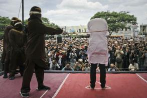 2 men in Indonesia caned for gay sex