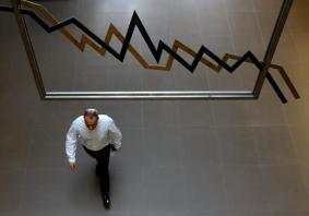SE Asia stocks brush aside China downgrade to inch up