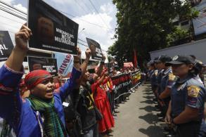 Protestors march in Manila against martial law declaration