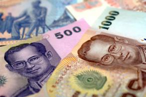 Foreign exchange rules eased, baht rises