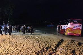 Tour coach careers onto beach in Pattaya