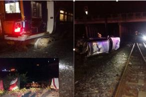 Train derails after BMW topples barrier onto tracks